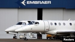 Private jets are seen at the Embraer headquarters in Sao Jose dos Campos, Brazil, May 14, 2013.