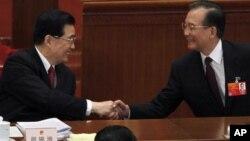 胡錦濤與溫家寶3月5日在中國人大開幕式上