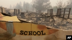 The burned remains of the Paradise Elementary school is seen Friday, Nov. 9, 2018, in Paradise, Calif. (AP Photo/Rich Pedroncelli)