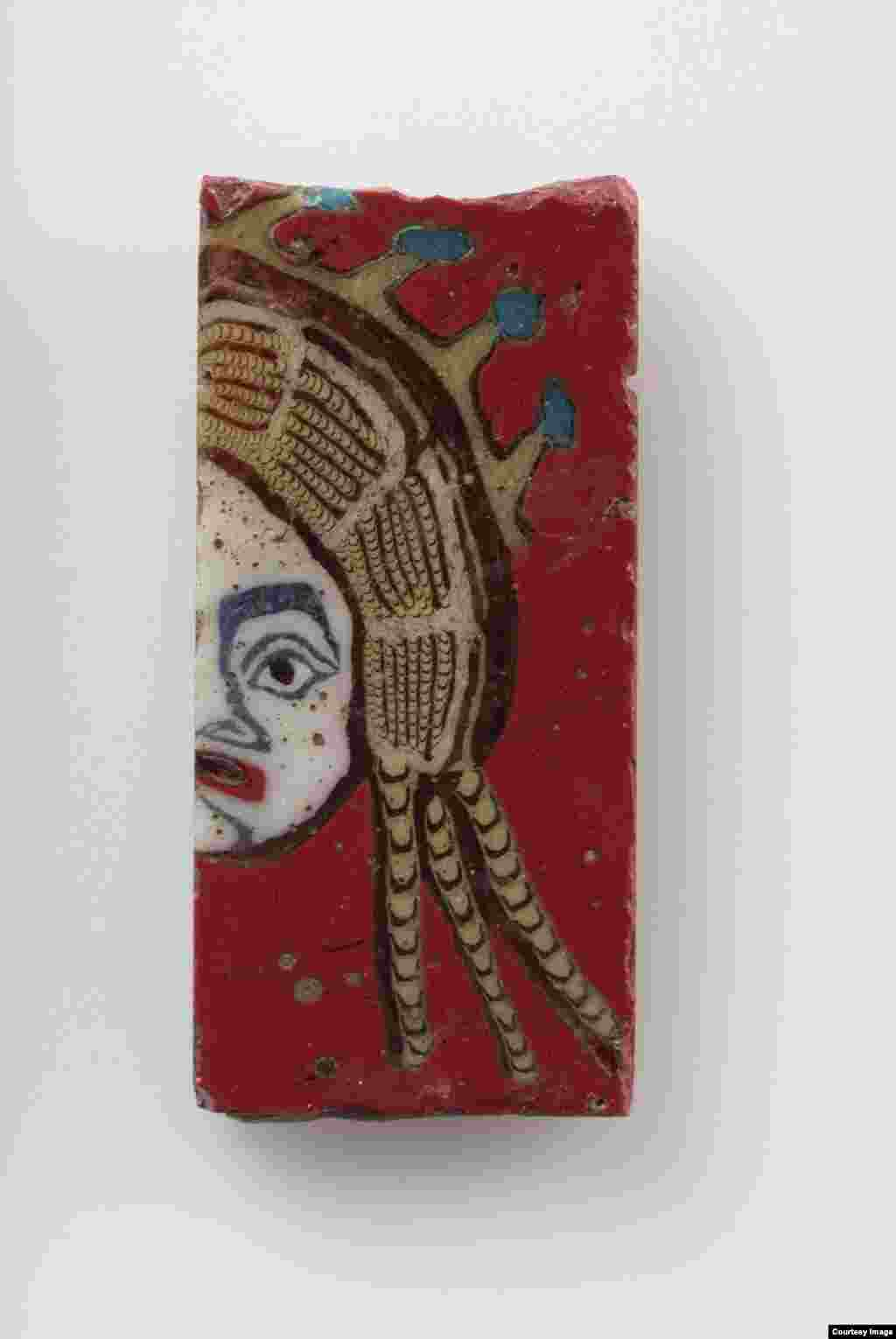 Tablet with the right half of a female mask, made from glass, Egyptian (305 B.C.E.-14 C.E.), Roman Period.