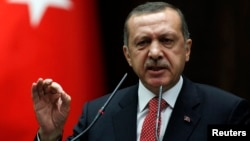Turkey's Prime Minister Tayyip Erdogan addresses members of parliament from his ruling AK Party (AKP) during a meeting at the Turkish parliament in Ankara June 26, 2012. The Turkish Armed Forces' rules of engagement have changed as a result of Syria shoot