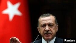 Firayim Ministan Turkiyya,Tayyip Erdogan a lokacin da yake halartar wani taron majalisar dokoki a birnin Ankara Yuni 26, 2012.