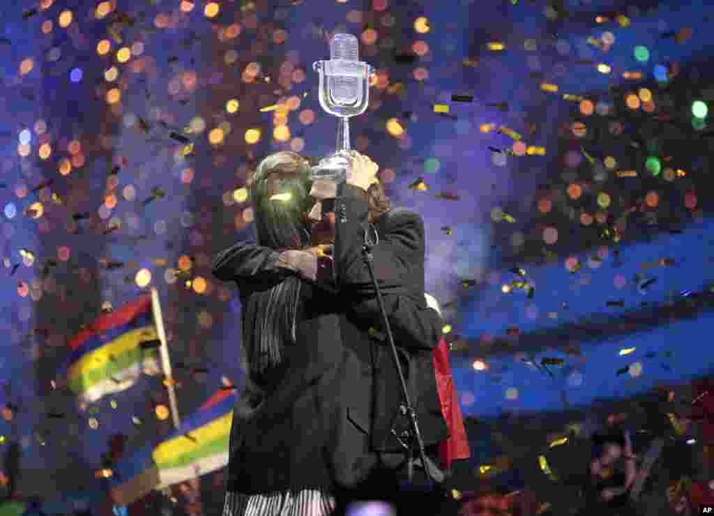 "Salvador Sobral from Portugal, right, embraces his sister Luisa after performing the song ""Amar pelos dois"" following his win in the Final of the Eurovision Song Contest, in Kyiv, Ukraine, May 13, 2017."