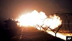 Nam Triều Tiên tập trận về đêm trên đảo Yeonpyeong, hải đảo bị Bắc Triều Tiên tấn công hồi năm 2010 làm 2 thường dân thiệt mạng