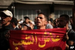 A demonstrator chants slogans during a protest in Casablanca, Morocco, Oct. 8, 2017.