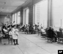 Guests take in the sea air on the veranda of the commodious Cape May Hotel in the New Jersey resort town of the same name in 1909.