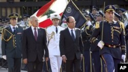 Lebanese President Michel Suleiman, second left, and French President Francois Hollande, second right, review honor guards, at the Presidential Palace in Baabda, east of Beirut, Lebanon, November 4, 2012.