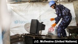 A U.N. peacekeeper takes part in a search for weapons and other restricted items at a camp for the displaced in Juba on Dec. 3, 2014.