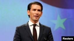 Austria's Chancellor Sebastian Kurz holds a news conference after meeting European Commission President Jean-Claude Juncker (not pictured) in Brussels, Belgium, Dec. 19, 2017.