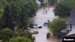 Vehicles surrounded by floodwaters are seen in the neighborhood of Sunnyside in Calgary, Alberta, Canada, June 21, 2013.