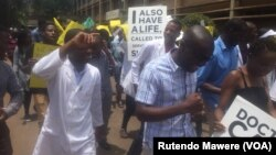 FILE: Protesting Zimbabweans doctors marching in Harare ...