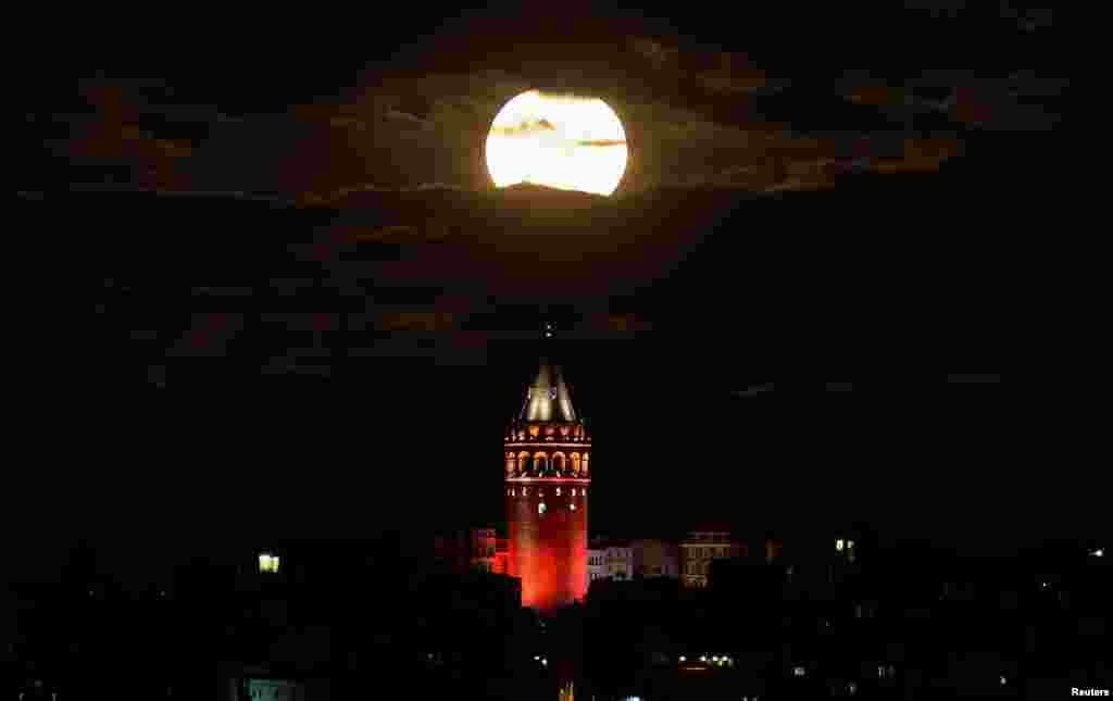 The supermoon is seen over the historical Galata Tower in Istanbul, Turkey.
