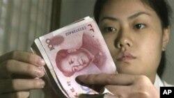 Kineska nacionalna valuta uz bok dolaru i euru?