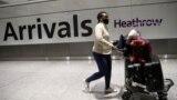FILE - A traveler arrives at Heathrow Airport, in London, Britain, Feb. 15, 2021.