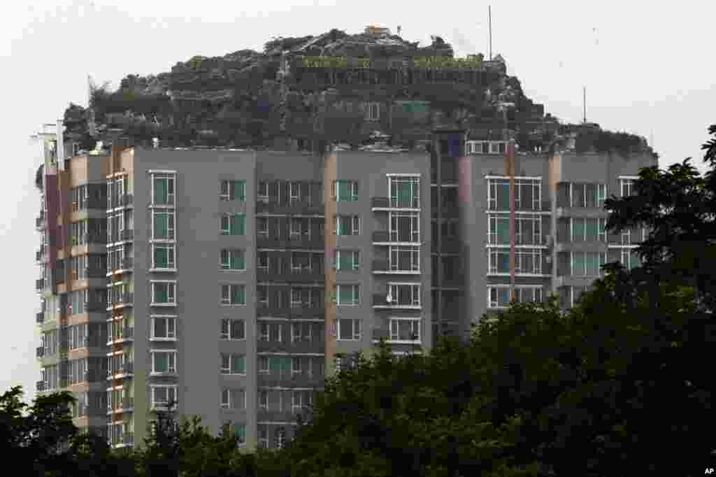 A rooftop villa complete with rocks and flora is built on top of a high rise residential building in Beijing, China. Beijing authorities are planning to demolish the rooftop villa that allegedly was built illegally atop a 26-story apartment block in the capital.