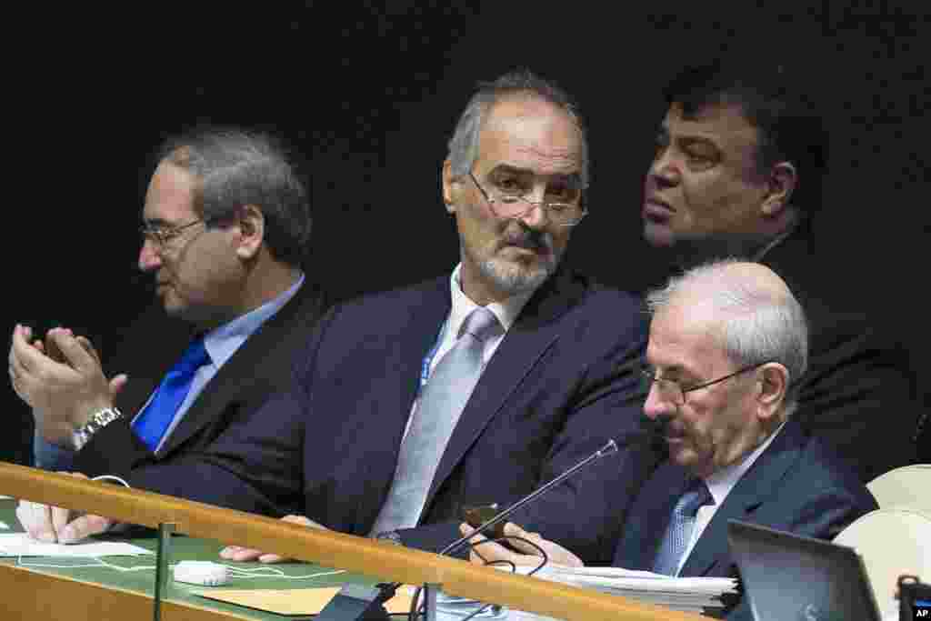 Syria's United Nations Ambassador Bashar Ja'afari waits on the bench before Deputy Prime Minister Walid Al-Moualem addresses the 69th session of the U.N. General Assembly at U.N. headquarters, Sept. 29, 2014.