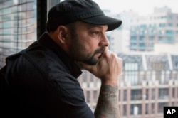 Christian Picciolini, founder of the group Life After Hate, poses for a photograph in his Chicago home, Jan. 9, 2017. Picciolini, a former skinhead, is an activist combatting what many see as a surge in white nationalism across the United States. He's doing it by helping members quit groups including the Ku Klux Klan and skinhead organizations.