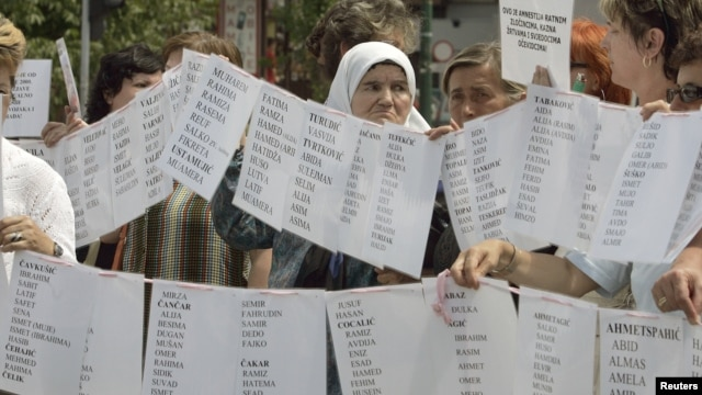 Bosnian Muslim women from Visegrad hold a peaceful protest of the U.N. war crimes tribunal's failure to include counts of rape in indictments against Bosnian Serb cousins Milan and Sredoje Lukic, Sarajevo, July 18, 2008.