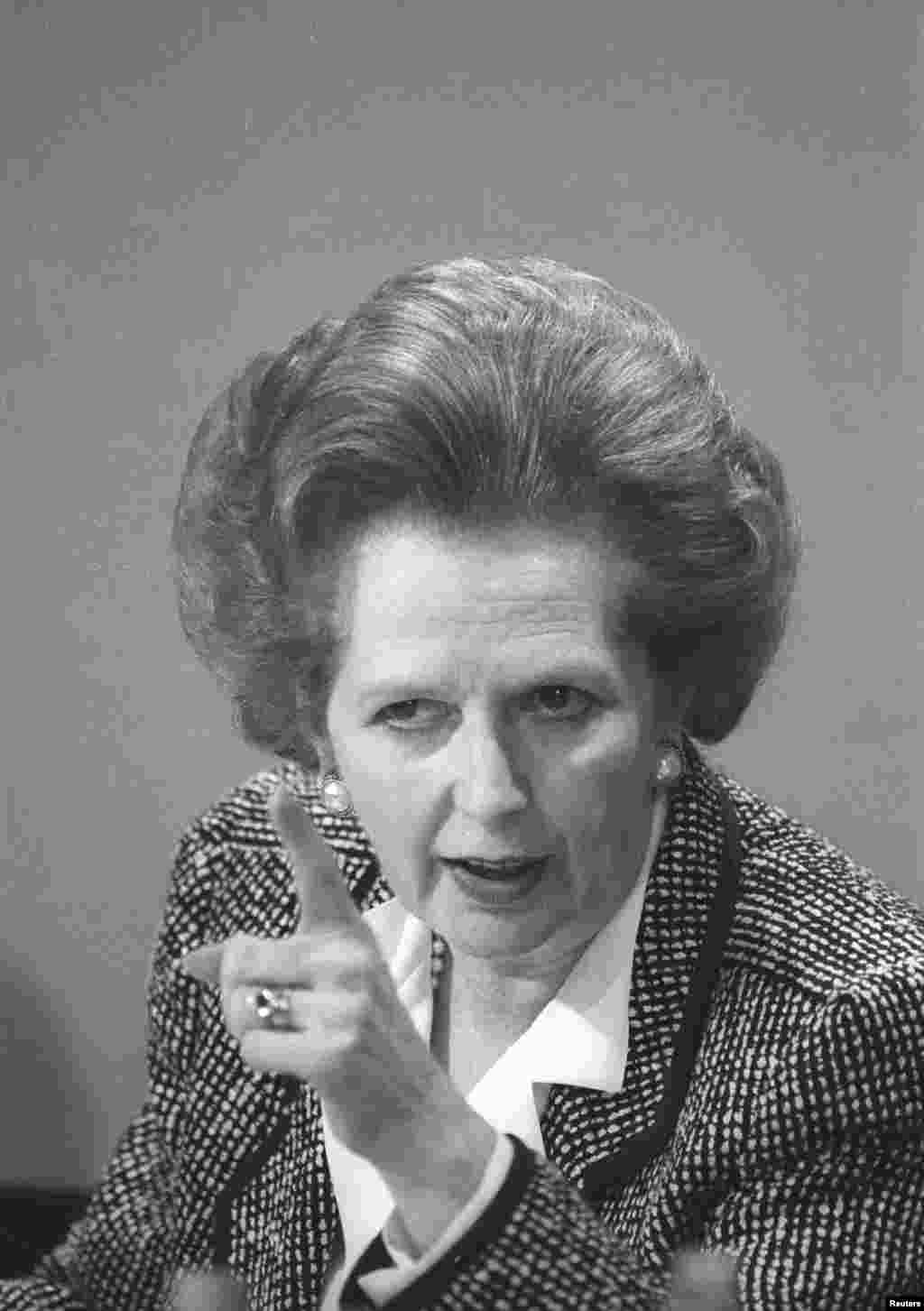 Then British Prime Minister Margaret Thatcher pointed a finger as she answers questions at a news conference in London, June 8, 1987.