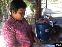 Pork Kep, a resident of in Siem Reap City's Chreav commune, was granted an Equity Card but has never used it for health care. March 15, 2019. (Sun Narin/VOA Khmer)