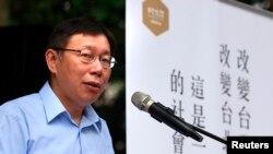 柯文哲竞选台北市长时对选民讲话。(2014年11月27日资料照)