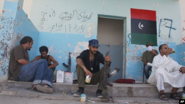Pro-NTC fighters waiting for action near the Gadhafi-held town of Bani Walid, September 4, 2011.