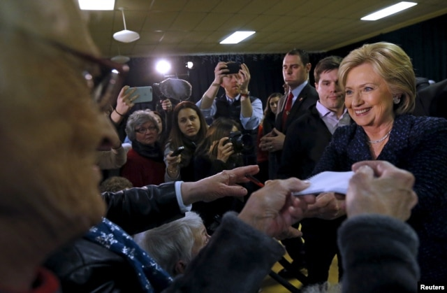 Democratic presidential candidate Hillary Clinton greets attendees at a campaign event in Vinton, Iowa, Jan. 21, 2016.