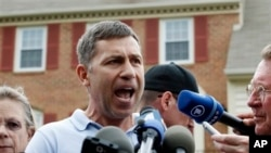 Ruslan Tsarni, the uncle of the Boston Marathon bombing suspects, speaks with the media outside his Maryland home.