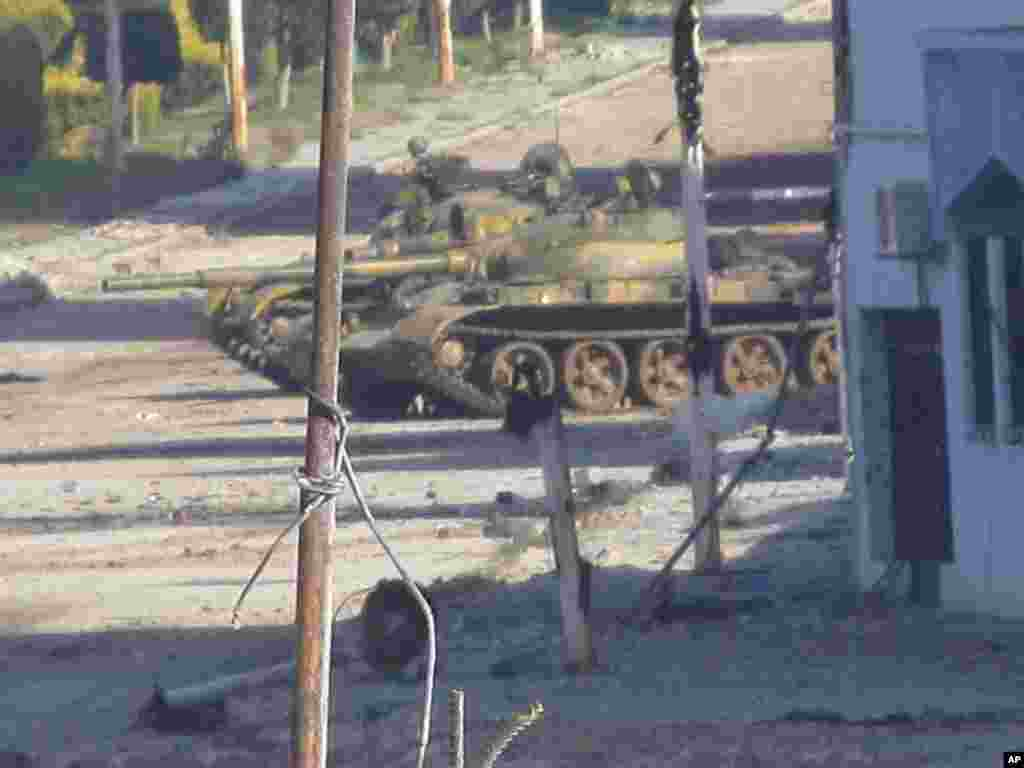 A Syrian tank is seen in Bab Amro near the city of Homs, February 12, 2012. Opposition campaigners said tank fire was concentrated on two neighborhoods at the forefront of opposition to President Bashar al-Assad. (Reuters)