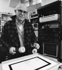 Max Mathews with an electric drum-computer instrument