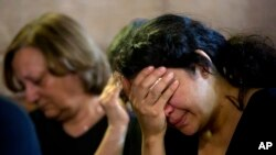 FILE - Loved ones grieve during prayers for the departed, remembering the victims of EgyptAir flight 804 in Cairo, Egypt, May 22, 2016.