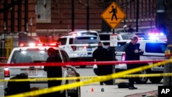 Crime scene investigators collect evidence from the pavement as police respond to an attack on campus at Ohio State University, Nov. 28, 2016, in Columbus, Ohio.