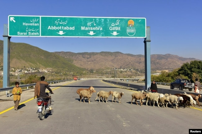A motorcyclist drives on a newly built Pakistan China Silk Road in Haripur, Pakistan, Dec. 22, 2017.