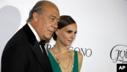 Fawaz Gruosi and Natalie Portman pose for photographers upon arrival for the De Grisogono party at the Hotel du Cap-Eden-Roc, on the sidelines of the 68th Cannes international film festival, Cap d'Antibes, southern France, May 19, 2015.