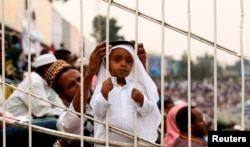 FILE - A Muslim boy attends Eid al-Fitr prayers to mark the end of the holy fasting month of Ramadan in Addis Ababa, Ethiopia, July 6, 2016.The Ethiopian government pardoned more than 700 prisoners in celebration of New Year's Day on the Ethiopian calendar and the Muslim holiday Eid.