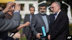 Iran's nuclear chief, Ali Akbar Salehi, right, speaks to journalists during negotiations with the United States over Iran's nuclear program in Lausanne, Switzerland, March 17, 2015.