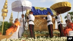 The casket containing the body of Cambodia's late King Norodom Sihanouk is carried by a flotilla of legendary phoenix in the procession on the street in Phnom Penh, Cambodia, October 17, 2012.