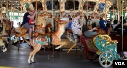 """The Glen Echo """"menagerie"""" carousel is made up of 40 horses, 4 rabbits, 4 ostriches, a giraffe, a deer, a lion, and a tiger, which stand in three concentric rings."""