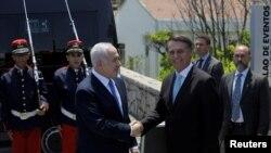 Le Président élu du Brésil, Jair Bolsonaro, et le Premier ministre israélien, Benjamin Netanyahu, avant un déjeuner à Rio de Janeiro, au Brésil, le 28 décembre 2018. Leo Correa / Pool via REUTERS -