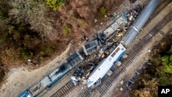 An aerial view of the site of an early morning train crash Feb. 4, 2018, between an Amtrak train, bottom right, and a CSX freight train, top left, in Cayce, SC. The Amtrak passenger train slammed into a freight train in the early morning darkness Feb. 4, 2018.