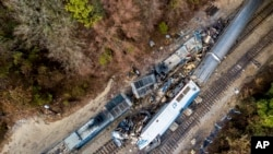 An aerial view of the site of an early morning train crash Feb. 4, 2018, between an Amtrak train, bottom right, and a CSX freight train, top left, in Cayce, South Carolina. The Amtrak passenger train slammed into a freight train in the early morning darkness Sunday, killing at least two Amtrak crew members and injuring more than 110 people, authorities said.