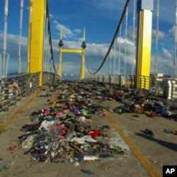 Piles of shoes and clothes were left on Diamond Bridge one day after the Water Festival stampede.