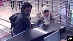 Security camera video footage obtained by Haberturk television on Jan. 12, 2015, shows Hayat Boumeddiene and a male travel companion arriving at Istanbul's Sabiha Gokcen airport on Jan. 2, 2015.