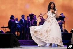 """Aretha Franklin performs at the world premiere of """"Clive Davis: The Soundtrack of Our Lives"""" at Radio City Music Hall, April 19, 2017, in New York."""