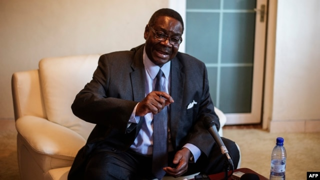Malawian presidential candidate Peter Mutharika, brother of the late president Bingu wa Mutharika, gestures during a press conference at his residence in Blantyre, Malawi, May 22, 2014.