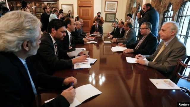 Cyprus' President Nicos Anastasiades (C) chairs a meeting with party leaders and governor of the Central Bank of Cyprus at the presidential palace in Nicosia March 20, 2013.