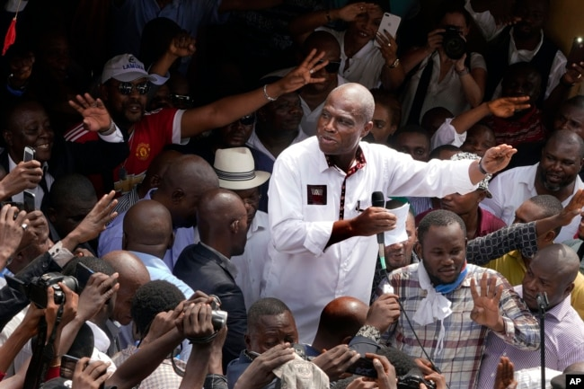 Congo opposition candidate Martin Fayulu greets supporters as he arrives at a rally in Kinshasha, Congo, Jan. 11, 2019.