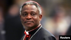 Cardinal Peter Kodwo Appiah Turkson of Ghana arrives to attend a mass led by bishop Leonardo Sandri of Argentina in St. Peter's Basilica at the Vatican, April 13, 2005.