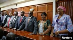 "Kenyan politicians Aisha Jumwa, Florence Mutua, Johnstone Muthama, Junet Mohammed, Timothy Bosire, Ferdinand Waititu, Moses Kuria and Kimani Ngunjiri stand in the dock at the Milimani Law Courts over alleged ""hate speech"", flagging growing tension in Keny"
