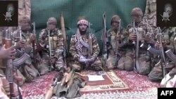 FILE - Abubakar Shekau, who claims to be the leader Boko Haram, is seen in a video screen grab, at an unknown location, Sept. 25, 2013.
